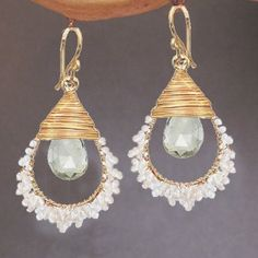 Ivory pearls and green amethyst wrapped on hammered drop hoops Cosmopolitan 110 by CalicoJunoJewelry on Etsy https://www.etsy.com/listing/178554458/ivory-pearls-and-green-amethyst-wrapped