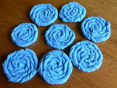 recycled tshirt flowers. Would be great to decorate pillows, hats, and scarves with...