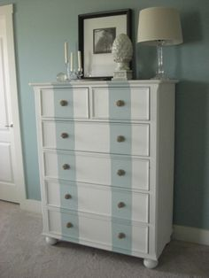striped dresser. A good way to get fun furniture without going overboard!