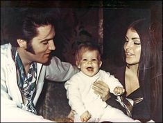 elvis and family   casual picture of mom and dad with baby Lisa Marie Presley