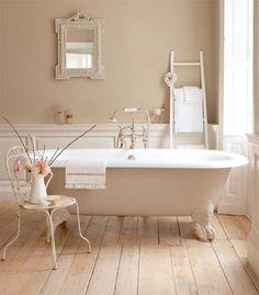 color pallet, clawfoot tub, & natural hardwood floors.