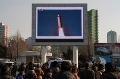 This photo taken on February 13, 2017 shows people in Pyongyang watching a public broadcast about the launch of a surface-to-surface medium long-range ballistic missile Pukguksong-2 at an undisclosed location on February 12.<br /><br /><br /> The UN Security Council on February 13 unanimously condemned North Korea's latest ballistic missile test as US President Donald Trump vowed to deliver a strong response to the provocation. / AFP / KIM Won-Jin        (Photo credit should read KIM…