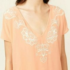 """""""Pretty in Peach""""top NWT Brand new with tags  Lovely peach top with cream embroidered details around the neckline. Pair with your favorite shorts and sandals or pair with a skirt, blazer and heels, crop  Sheer peach material 100% polyester Length almost 24"""" Bust approx 22""""   💗Price is firm 💗No trades SASSY Tops Blouses"""