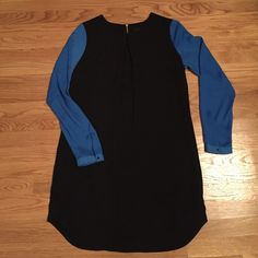 Mossimo Blue and Black Colorblock Shift Dress Mossimo Blue and Black Colorblock Shift Dress. Size Medium. Zipper back. Snap cuffs. 100% polyester. Mossimo Supply Co Dresses