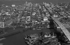 """A stunning aerial photo of False Creek between Burrard and Granville Bridges. If you zoom in far enough, you see that what is now the Granville Island Public Market used to be """"Pacific Bolt Co. Ltd."""". Thank god for that change!"""