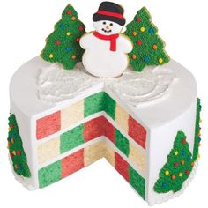Jolly Checkerboard Cake - The holiday spirit is popping up everywhere on this festive creation. Christmas tree cookies and a happy snowman decorate a bustling cake of red, green and white. Create this Christmas cake using the Checkerboard Cake Pan Set.