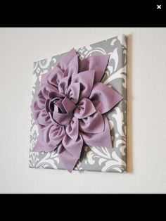 Decorate a plain canvas like this with felt flower petals. Cute for nursery??