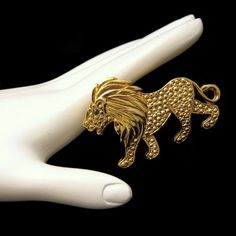 Vintage Large Figural Lion Brooch Pin Leo Zodiac Green Rhinestone Eye Goldtone from http://stores.ebay.com/My-Classic-Jewelry-Shop. A great looking vintage Leo lion brooch with beaded and shiny surfaces and a green rhinestone eye. Very bold! :)