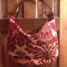 Burgundy and Taupe Vintage Purse Vintage mid sized bag with beautiful burgundy and taupe pattern. It's a classy mix of cloth- velour like and faux leather. It has one zip pocket on the inside and is like new... carried MAYBE 3x. Aurielle Bags