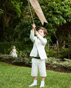 """A ring bearer carried a sign that read, """"Hip Hip Hooray"""" in gold lettering."""
