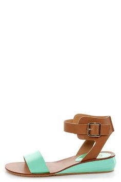 Check it out from Lulus.com! Get the hottest silhouette of the season with the simply splendid Kelsi Dagger Genna Jade and Cognac Ankle Cuff Sandals! Mint patent toe band pairs with a tan leather ankle cuff that sprouts from the quarter, and adjusts with a shiny golden buckle. 1.5