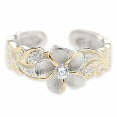 A spectacular foot ring, the flower includes a brushed look with a shine to it, the CZ is set in to the heart securely, the ends of the petals are defined in gleaming gold, the band is a nice equilibrium of silver and gold scroll leaves and the material is strong. http://www.amazon.com/dp/B003XP50V8/ref=nosim?tag=x8-20