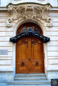 ARCHITECTURE – on the upper east side, a stunning door surrounded by elegant and striking detail.
