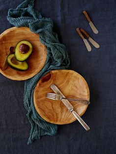 These mid-sized wooden bowls are hand-carved by Enrico and feature a prominent natural wood grain.