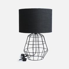 Wire table lamp black shade nolden bros lighting superbalist handmade here in south africa by nolden bros this table lamp has been skilfully designed with a black metal base and is topped off with a white drum shade greentooth Images