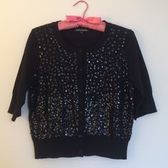 Express Sequin Front Button Up Cardigan M Add some sparkle to your look with this sequined button front cardigan! The beautiful mirrored effect will have all eyes on you! Elbow length sleeves. Black rhinestone buttons. Button front closure. From Express Design Studio. Cotton/Nylon blend. New condition! Size M Express Sweaters Cardigans