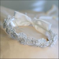 """Flower Girl Head Wreath - Pearl Garden - White -   This head wreath is a combination of embroidered flower blossoms, satin leaves, and pearl buds. Togethere, this collection is assembled on a wire band measuring 5.5"""" in diameter. Back of wreath is accented with a single soft satin bow with streamers and pearl center. To make your flower girl more comfortable, two hair combs are secured on the head wreath to allow the wreath to fit all hair styles."""