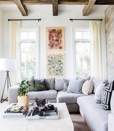 Grey furniture in the living room perfectly combined with a nice brick wall and wood-plated ceiling