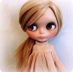 Doll with light hair & dark brown eyes