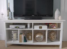 I am in love with this TV stand hack of the IKEA Hemnes sofa table - especially the fact that it has lights in the cubbies! I wish I had enough room for this now. Ikea Sofa Table, Console Ikea, Console Table, Sofa Tables, Coffee Tables, Tv Stand Hack, Ikea Tv Stand, Tv Stand Toy Storage, Ikea Hemnes Tv Stand
