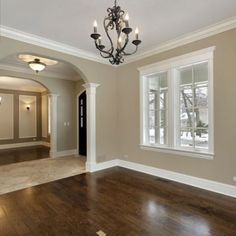 Dark wood floors and white baseboards/ window trim :). Boys rooms.