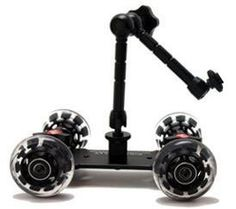 """P Pico Flex Table Dolly, a 11"""" Friction Arm, Shark Clip By Photography by P $118.88. This kit includes a Pico Dolly, 11 inch articulating friction arm, and a shark clip. This is the perfect kit for taking videos with smartphones, and small video cameras including the mirrorless cameras. The arm adjusts to just about any position."""