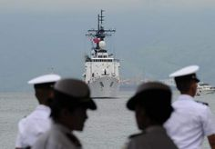 Philippine sailors chat as the BRP Ramon Alcaraz, a high-endurance Hamilton-class cutter that had been decomissioned by the US Coast Guard and acquired by Manila, arrives Aug. 6 at the former US naval base in Subic Bay, Zambales province. The Philippines vowed intensified sea patrols as it welcomed the ship.