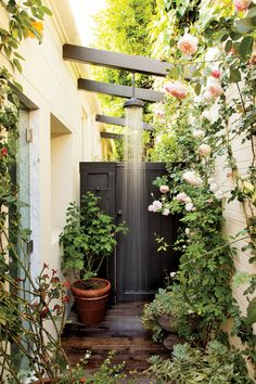 The vibe is Los Angeles meets the Cotswolds in an outdoor shower by Madeline Stuart & Assoc.