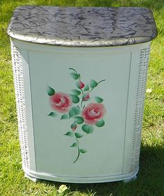 Vintage Floral Metal Wicker Clothes Hamper  When I was about 4 years old, my sister stuffed me in one of these and sat on the lid for what seemed like hours. The start of my claustrophobia...