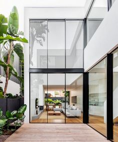 The architect uses two structures to design Cloud House. These structures are interconnected by the internal courtyard of the house on the ground level and there is also an open walkway on the upper l Exterior Design, Interior And Exterior, Internal Courtyard, Interior Design Awards, Australian Homes, Interior Architecture, Residential Interior Design, Australian Architecture, Futuristic Architecture