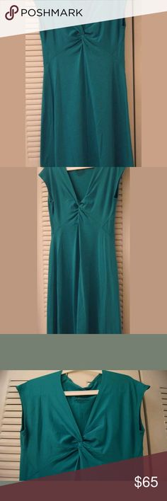 """PATAGONIA SLIM FIT SHORT SLEEVE CASUAL MIDI DRESS Imported.  92% Nylon / 8% Spandex.  SLIM FIT: Closer fitting. (Slim-fitting technical garments may be worn over baselayers and light midlayers).  DRESS LENGTH: Dress Length.  LENGTH: 41.5"""".  V-neck.  Twisted chest.  Lightweight.  Beautiful, flirtatious and elegant.  Ideal to wear for work or any casual occasion.  Never used.  High quality.  Satisfaction guaranteed.  Great price.  Excellent purchase choice. You will not regret.  """"THE DRESS…"""