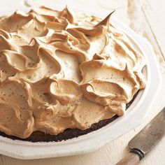 Completely spread meringue to the edge of the hot pie; seal by lightly pressing to the crust.