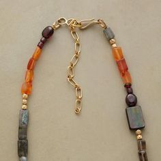 """Fiery carnelians and deep red garnets smolder among gems of labradorite, smoky topaz, mother of pearl, glass beads in smoky hues and 14kt goldfill beads. 14kt hook clasp. Exclusive; hand strung in USA. 30"""" to 32""""L."""