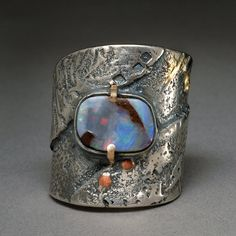 Erosion Ring Sterling Silver and 18K Gold with Copper detail and Boulder Opal. Size  7 1/2