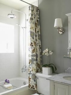 contemporary gray bathroom with an extra long shower curtain hung close to the ceiling, making the bathroom look HUGE!... Beautiful Bathroom Inspiration: Contemporary Shower Curtain Ideas from Bathroom Bliss by Rotator Rod