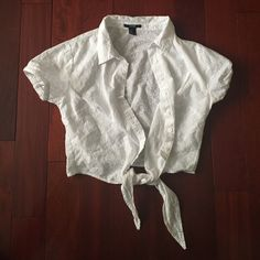 White button up top White shirt sleeve button up top. The ties on the bottom can be untied and adjusted. Slightly cropped. Only worn once. Forever 21 Tops Button Down Shirts