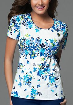 Style Code: A round neck top that features piping around the neck with an inside adjustable drawstring at the side front waist, bust darts, patch pockets, back elastic and side vents. Work Uniforms, Nursing Uniforms, Hospital Uniforms, Nursing Career, Stylish Scrubs, Fashionable Scrubs, Cherokee Uniforms, Best African Dresses, Medical Scrubs