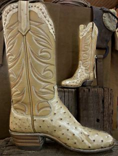 Creme colored full quill ostrich with a matching collar and pullstraps.  Tops were made in a tan calfskin top.  Natural colored #3 heel and a d toe.  Paul Bond Boot Co. Nogales, Arizona