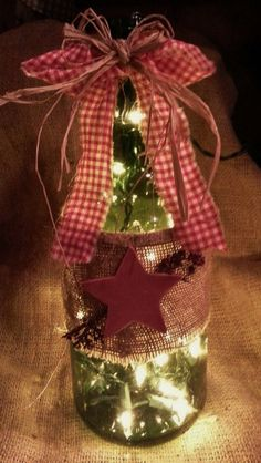lighted burlap wine bottle with star