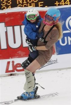Sarah does the last of her 186 world cup races in a chic dress, her son in her arms. Coolest 2012 WC image.
