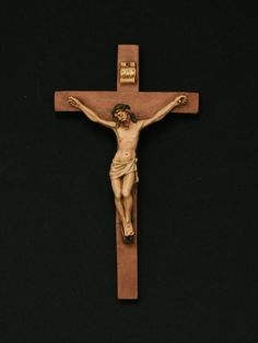 Why the Crucifix, and not just an empty cross: it's a reminder of how God is Love-- he chose to suffer with and for us. That he suffered death and descended into Hell tells us that he is with us every step of the way, and that sin and death has its limits. The Sacramental life of the Church is conformed to Him crucified so that in suffering with Him, we rise with Him: Catholicism doesn't just demand spiritual toughness; it imparts spiritual toughness.