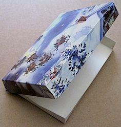 Tons of templates and instructions for different sized gift boxes out of Christmas Cards!