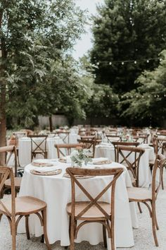 Quaint and delicately decorated reception with rustic cross back chairs | Image by Kay + Bee #traditionalwedding #wedding #weddinginspiration #diywedding #gardenwedding #elegantwedding #reception #weddingreception #receptiondecor #tabledecor #weddingfloraldesign #floraldesign #weddingflowers #centerpieces
