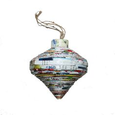These unique Vietnamese christmas ornaments are made using pages from discarded magazines, which are rolled into flat strips, dipped into glue and hung to dry. Paper Christmas Ornaments, Christmas Decorations, Holiday Decor, All Things Christmas, Vietnam, Recycling, Heart, Handmade, Christmas Decor