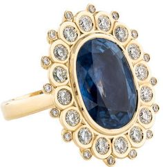 18K yellow gold cocktail ring featuring 16.83 ct. bezel set oval unheated burmese sapphire at center with round brilliant diamond halo
