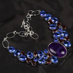 """Amethyst Agate Blue Topaz an Ruby Necklace  This is a Amethyst Agate Necklace with Blue and Ruby Quartz Stones ..This Pendant Necklace is about 19"""" in Diameter and absolutely beautiful. with beautiful colors .A Defanent eye catcher for sure.These colors are simply awesome"""