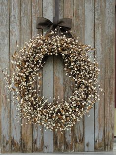 Gorgeous, full Ivory Pip Berry Wreath. Beautiful ivory pip and round mixed berries with a touch of tiny leaves added to an 18 grapevine wreath