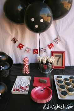 bowling tablescape at bowling party, ballons with white dots painted on them!
