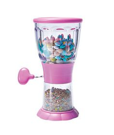 I think I need this! ;) Topper Chopper turns candies and nuts into crushed ice cream toppings.