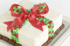 M & M wrapped cake. This is a Christmas cake but the idea works in any colours.